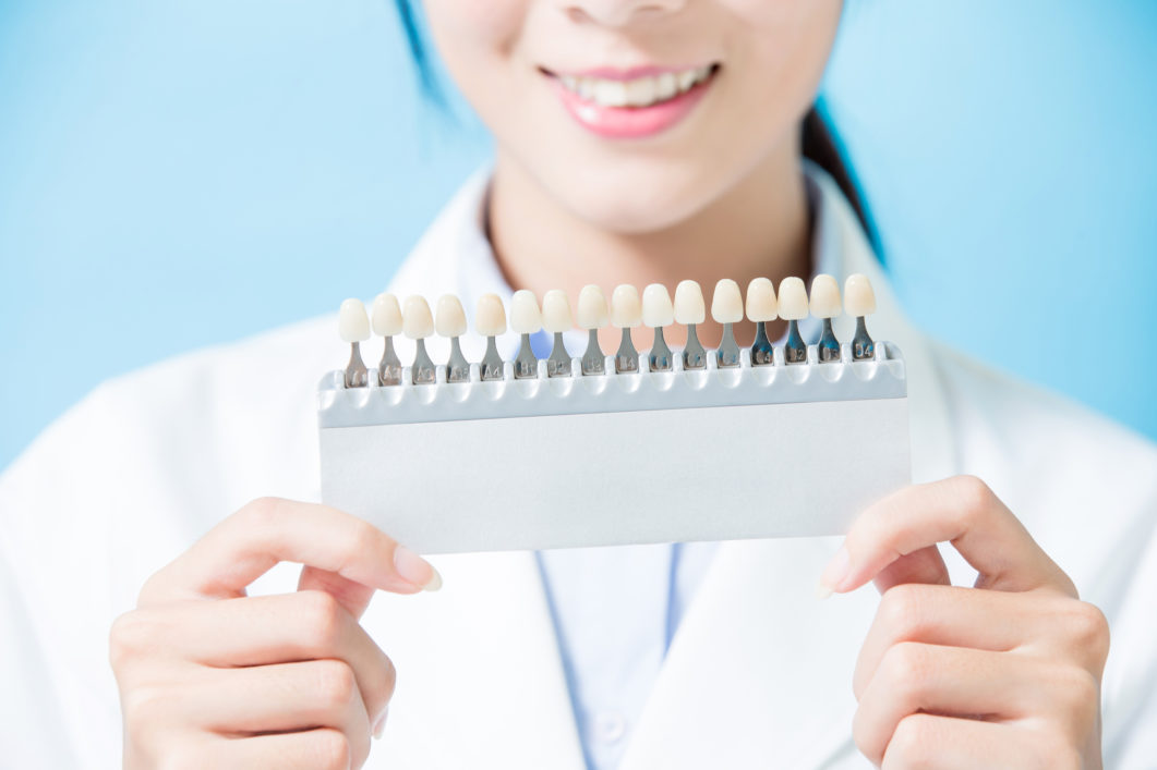 dentist take tooth whitening tool